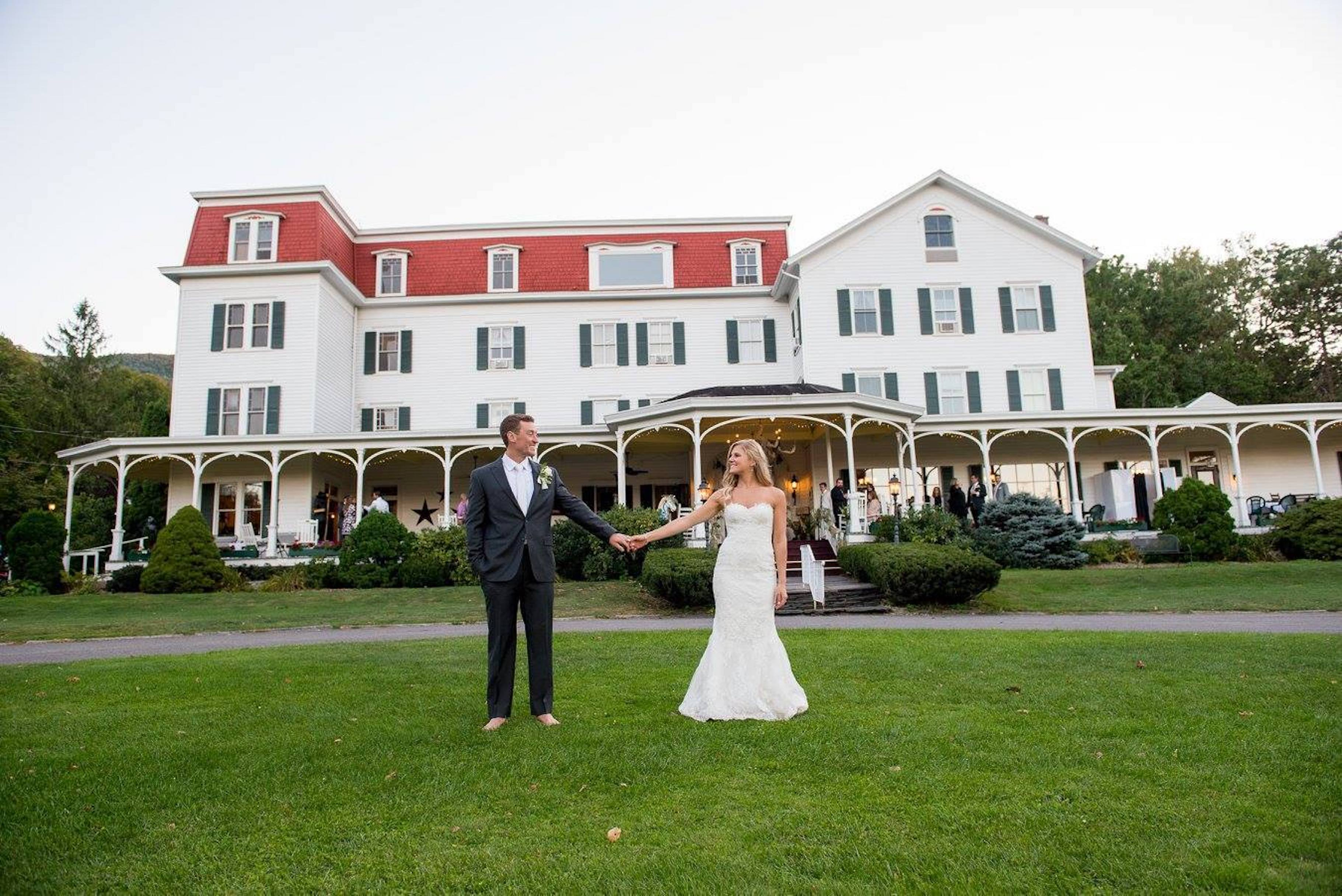 Bride and Groom standing on the lawn.