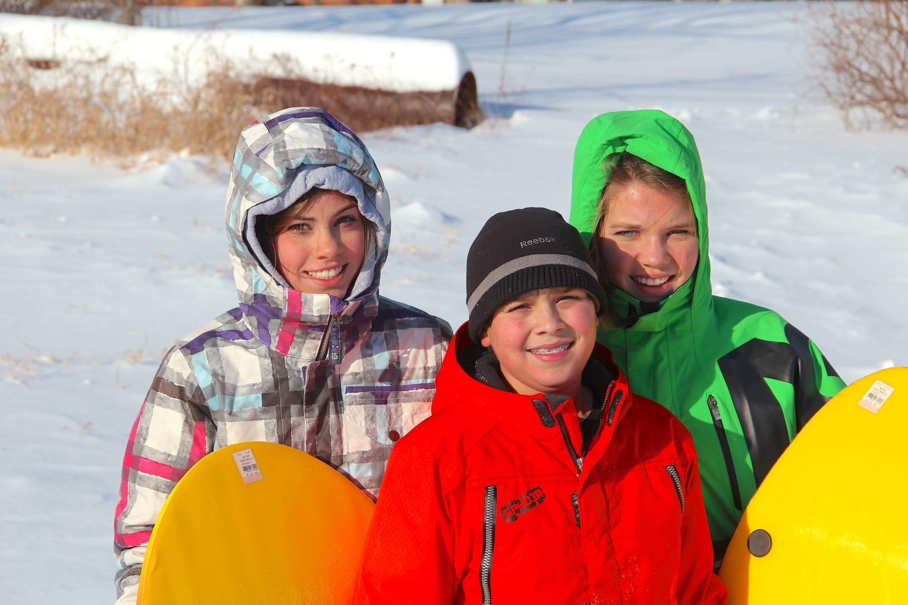 Kids in wither with sleds.