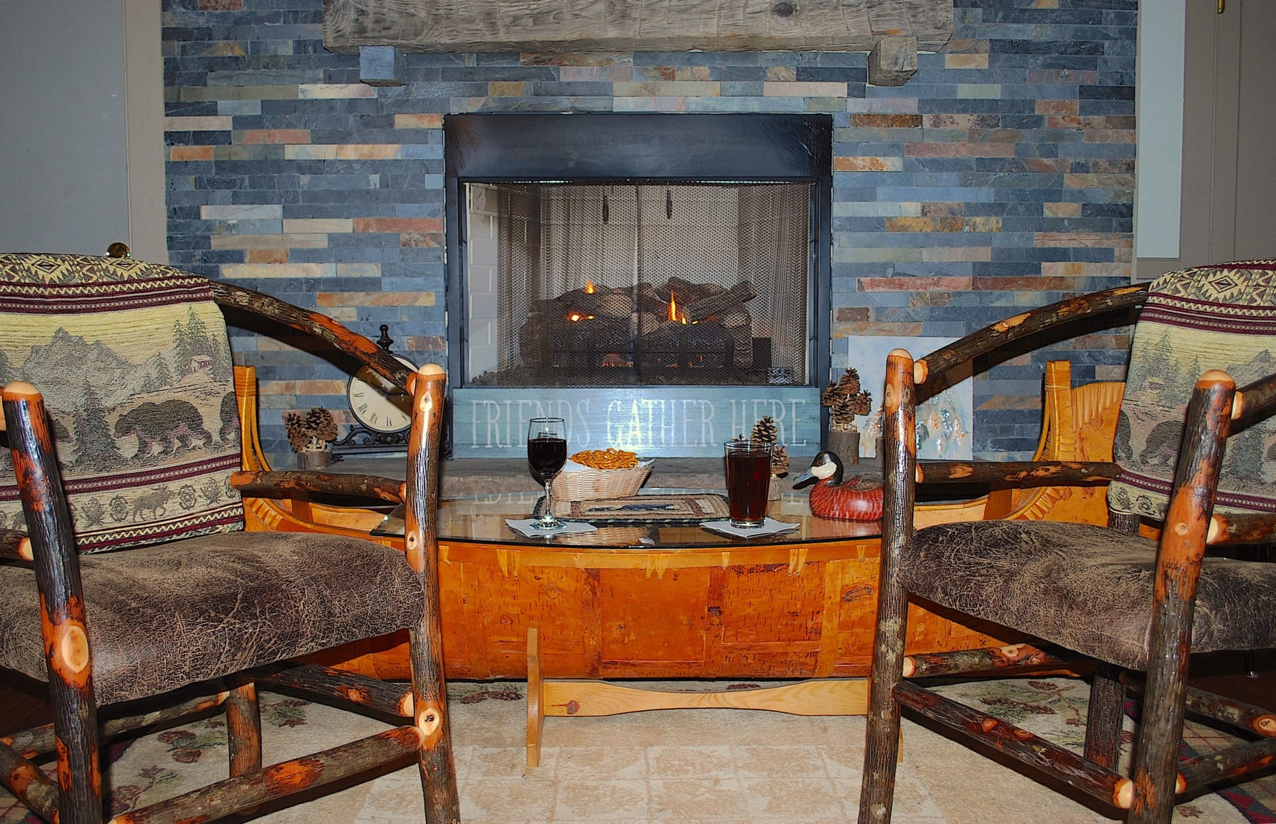 Log chairs and fireplace.