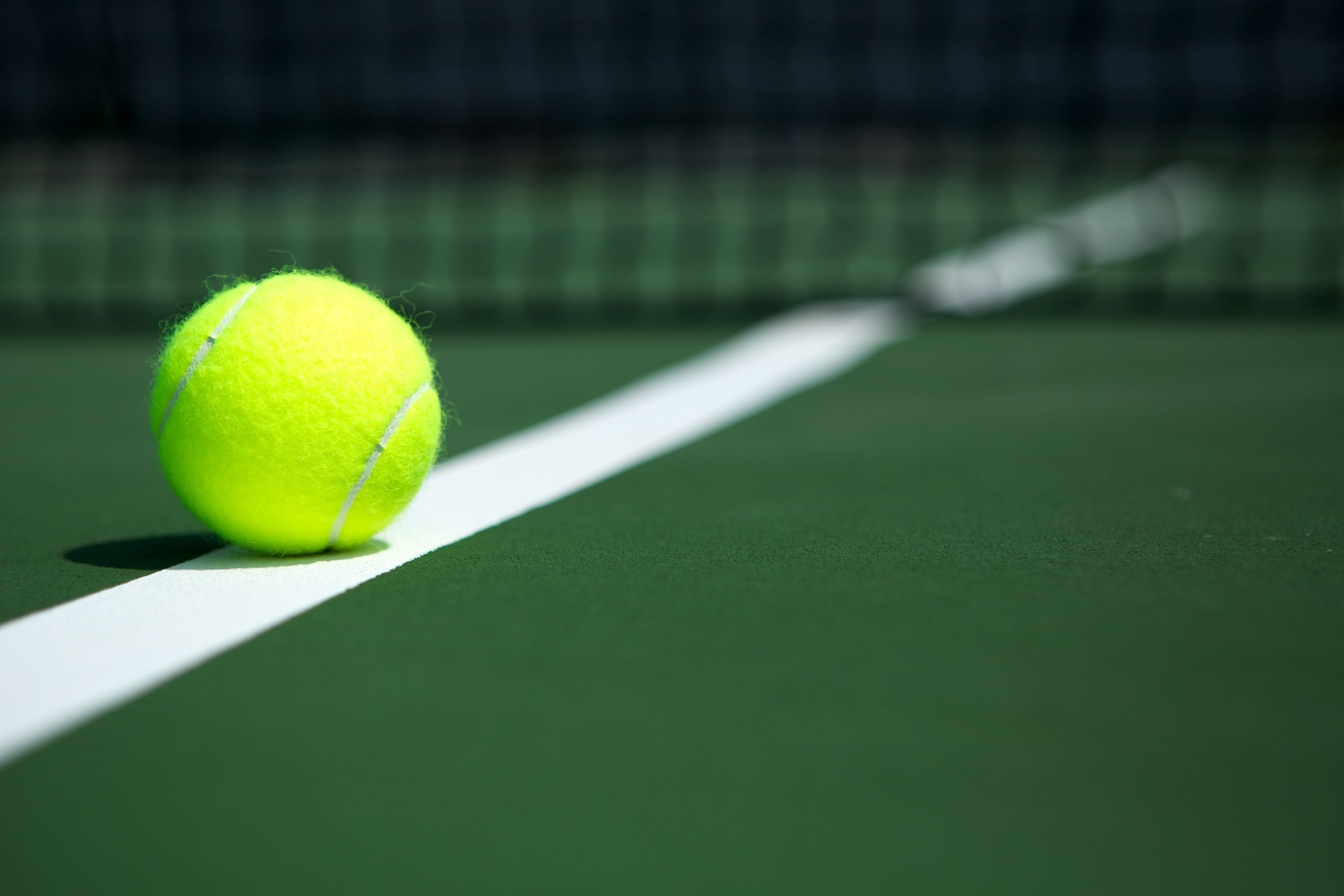Close up of tennis ball on the court.