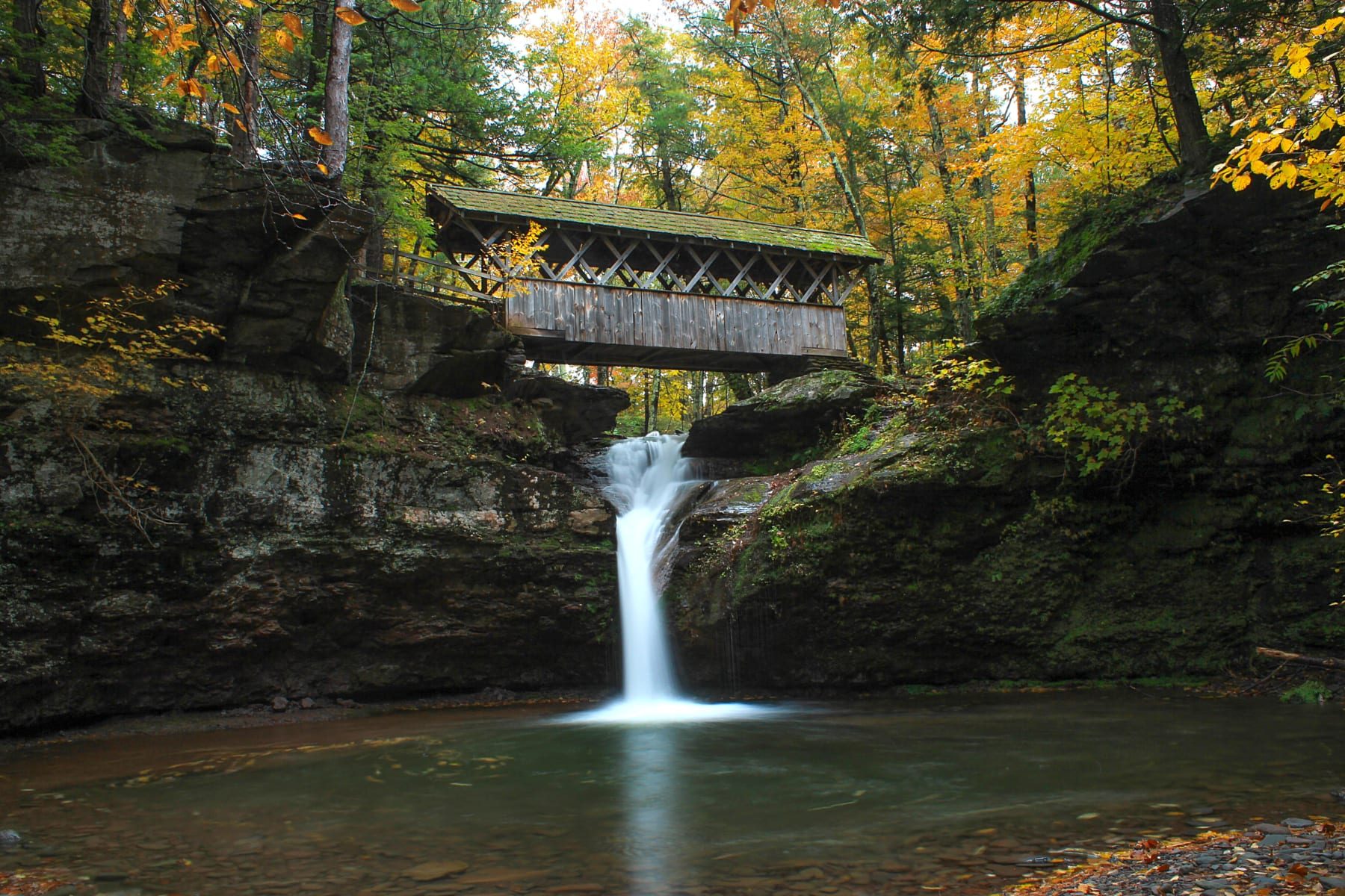 Waterfalls with covered bridge
